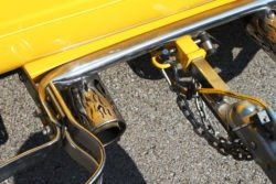 yellow Ford with trailer exhaust tip detail